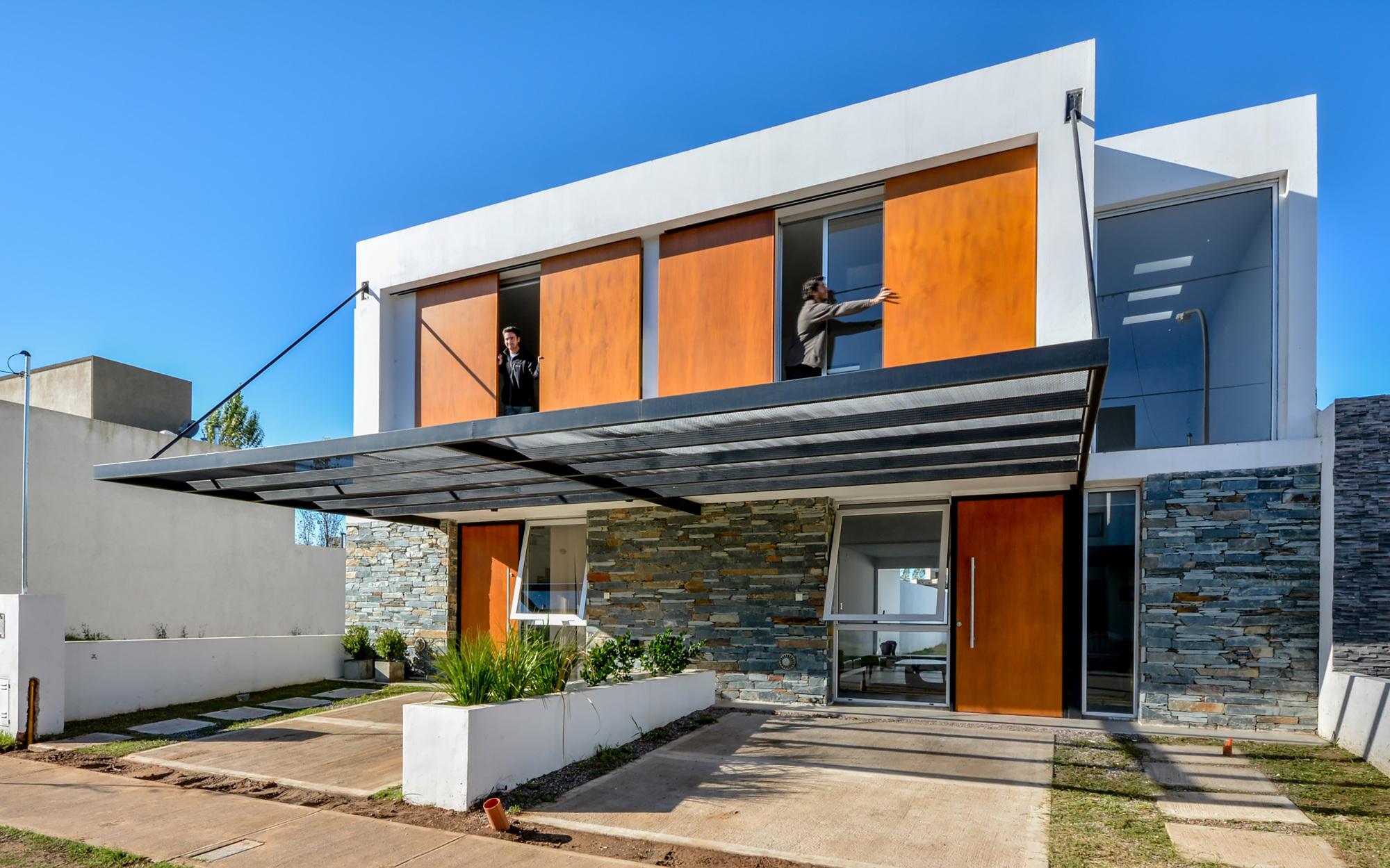 Galeria de casas geminadas estudio a 3 17 for Parasoles arquitectura