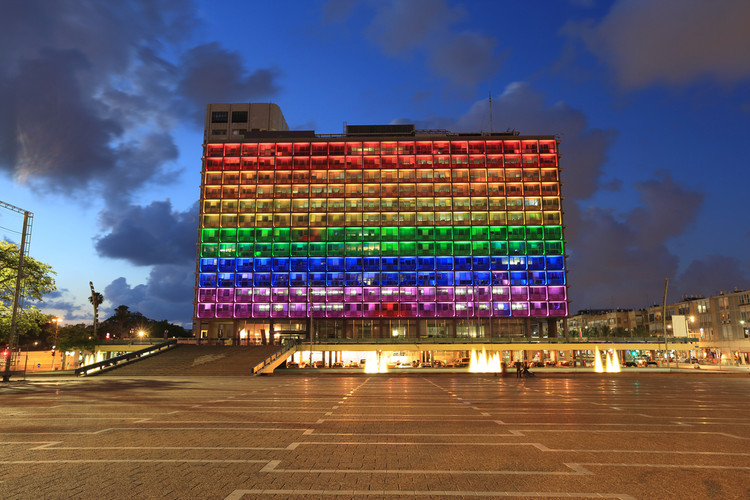 Rainbow flag lighting over Tel Aviv city hall building for pride month Image © Mordechai Meiri via Shutterstock.com
