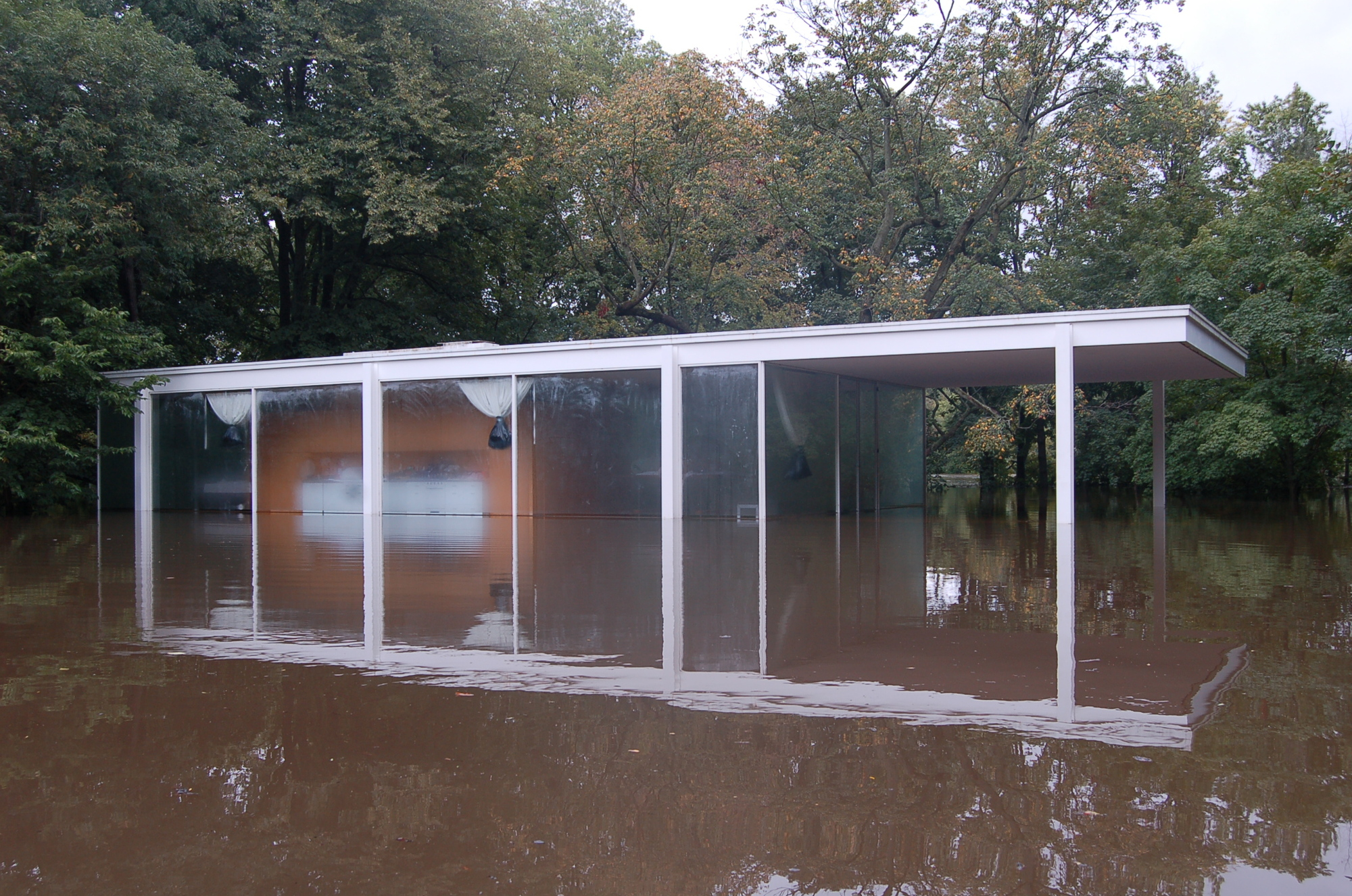 Flood waters surround the Farnsworth House  Image via National Trust for Historic Preservation. A Virtual Look Into Mies van der Rohe  39 s Farnsworth House   ArchDaily