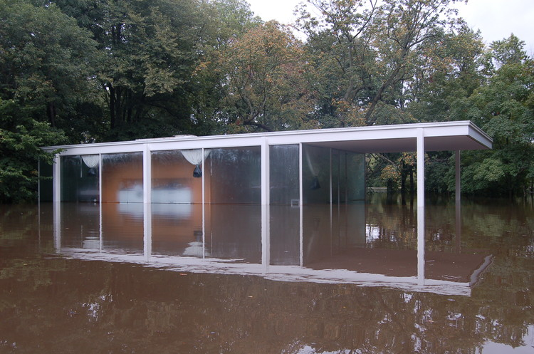 Flood waters surround the Farnsworth House. Image via National Trust for Historic Preservation.