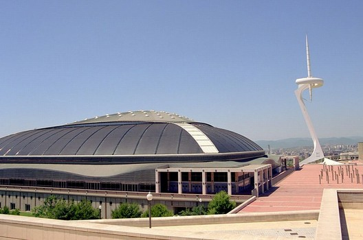 The Palau Sant Jordi, Isozaki's design for the 1992 Barcelona Olympics. Image <a href='https://commons.wikimedia.org/wiki/File:Barcelona_Palau_San_Jordi_001.jpg'>via Wikimedia</a>. Image taken by Wikimedia user German Ramos in public domain