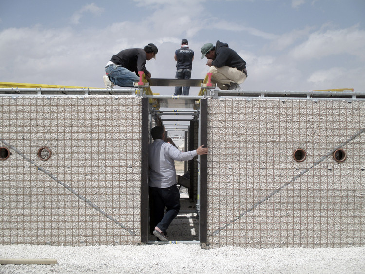 These Schools for Refugee Children in Jordan are Built Using Scaffolding and Sand, Za'atari Refugee Camp, Jordan. Image Courtesy of Pilosio Building Peace