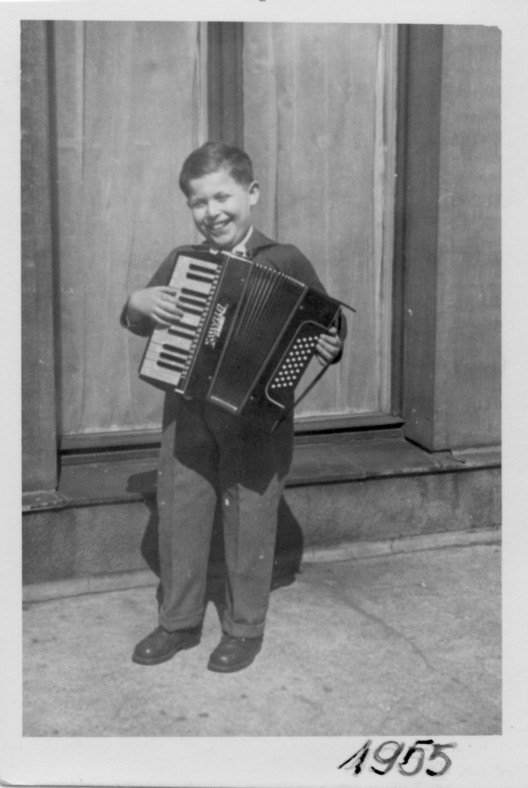 Daniel Libeskind with accordion in Lodz, Poland, 1955