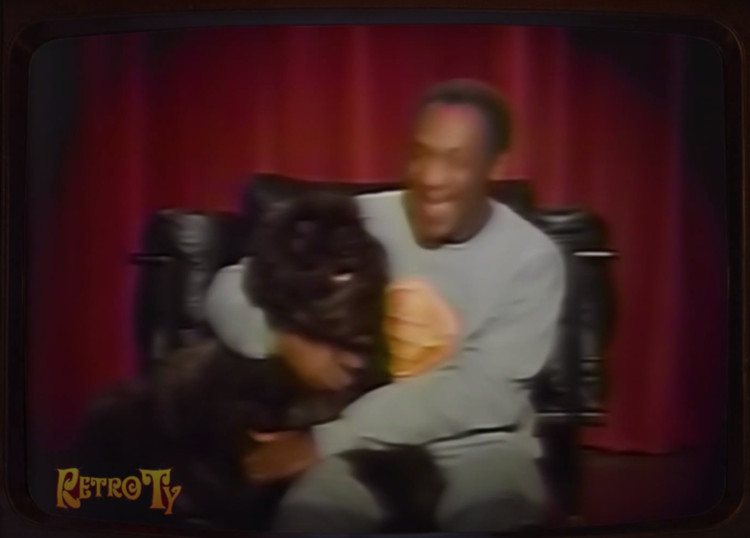 A still from a 1987 commercial for Kodak: featuring Bill Cosby, a dog, and a Corbusier-designed chair.