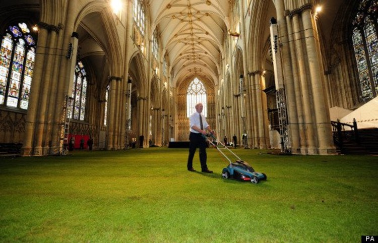 The Nave of York Minster covered in 1500 square meters of real grass for the York Minster Rose Dinner © Standalone Photo