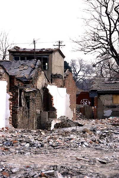 A destroyed Hutong in Beijing, China. Photo via Wikimedia Commons user Boris van Hoytema.