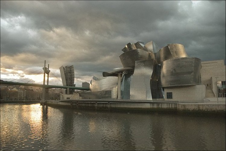 "Gehry's Guggenheim Museum in Bilbao, which inspired cities across Spain to get their own ""Guggenheim,"" many of which now stand empty/unfinished in the light of the country's economic crisis. Photo via Flickr User CC Txanoduna"