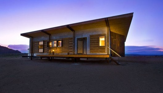 Whitehorse, an environmentally sustainable home in the Navajo Nation built using salvaged and found materials, modern technologies, and traditional building methods. © DesignBuildBLUFF Studio