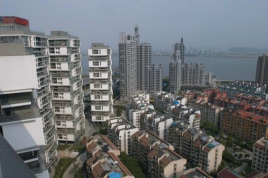 Vertical Courtyard Apartments © Lu Wenyu, Courtesy Amateur Architecture Studio