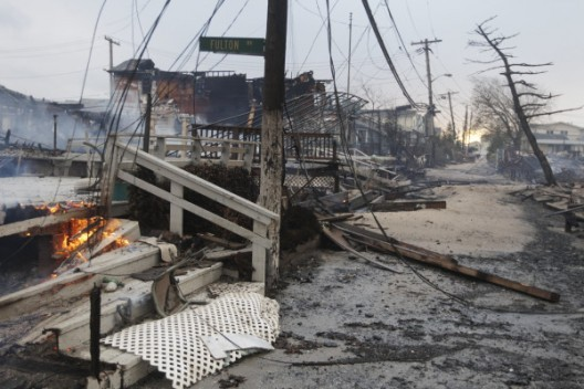 """Twitter User: @c_heller """"Another photo out of Breezy Point. The damage is stupefying. (Frank Franklin II, AP) http://twitpic.com/b8sg51″"""