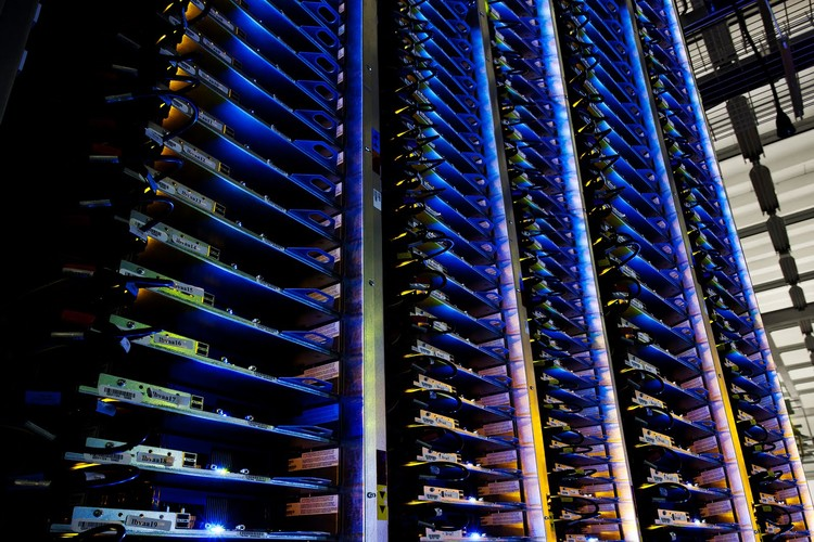 """Servers at Google's Data Center in Hamina, Finland; """"Blue lights like these mean everything is functioning properly on the server floor."""" Photo © Google/ Connie Zhou"""