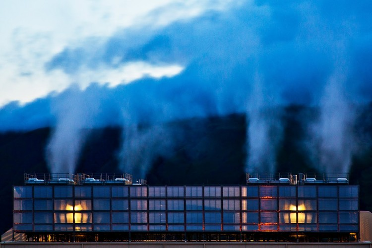 """Cooling Towers at Google's Data Center in The Dalles, Oregon: """"Plumes of steam rise above Google's cooling towers. When you can see the water vapor – meaning humidity and temperatures are low – the cooling towers are at their most efficient."""" Photo © Google/Connie Zhou"""