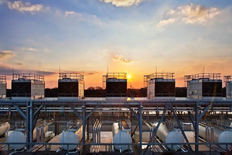 """A sunset over Saint Ghislain, Belgium illuminates Google's water storage tanks and cooling towers."" Photo ©Google/Connie Zhou"