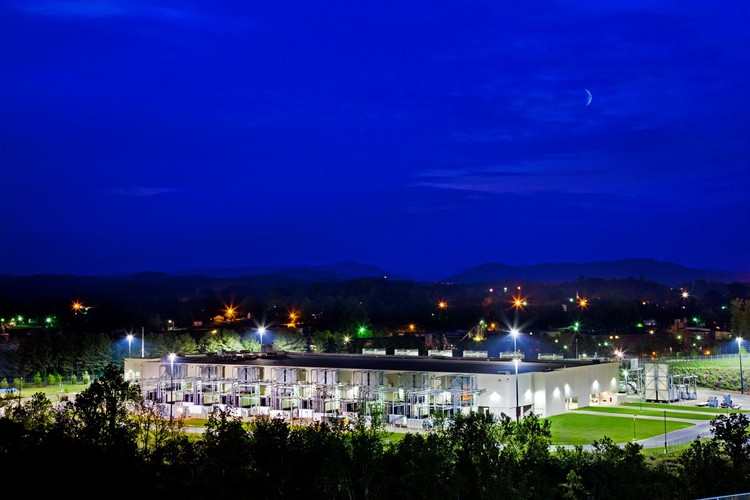 """A cool spring night falls on Google's Lenoir, North Carolina data center. From this beautiful location, they're able to provide their services – in the middle of the night – to the entire world."" Photo © Google/Connie Zhou"