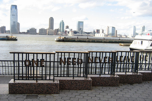 Poetry in a fence in NYC. Subject of one of Mars' Favorite Episodes. Photo, Battery Park City- World Financial Center Plaza, via Flickr User CC wallyg.