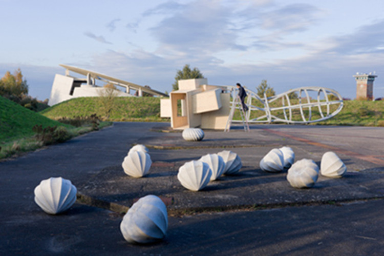 View of Raketenstation Hombroich, with sculptures by Katsuhito Nishikawa and Oliver Kruse (foreground) and the House for Musicians, by Raimund Abraham (left) (Raketenstation Insel Hombroich, near Neuss, Germany); © Iwan Baan