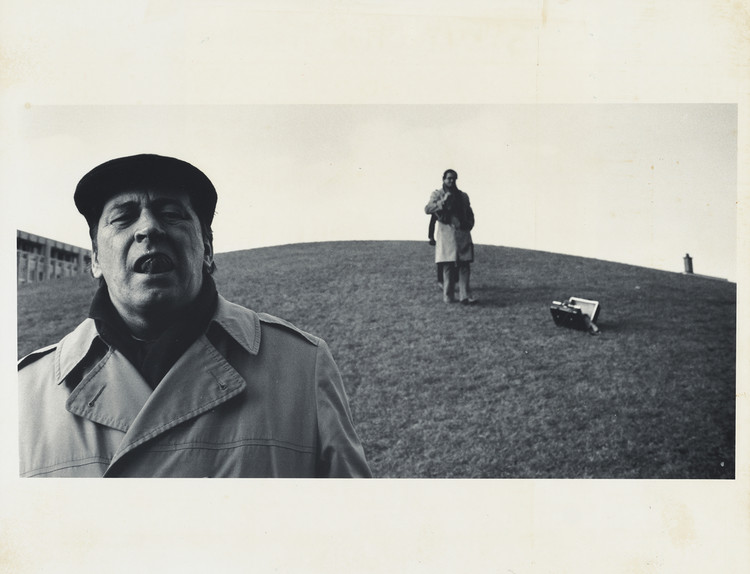 "From the exhibition: Photograph by Peter Smithson, 1972, showing ""Shadrach Woods Descending the Central Green mound, Ivor Prinsloo behind."" Frances Loeb Library"