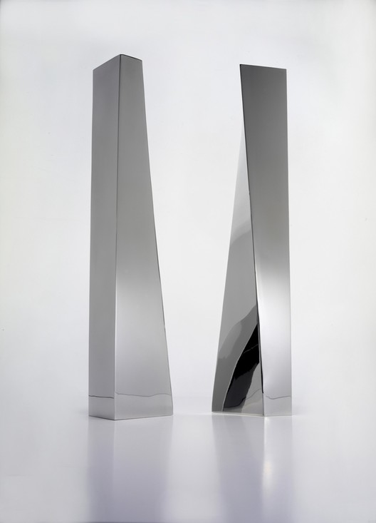 "Crevasse Vases, 2005. Zaha Hadid (Iraqi, b. 1950). Stainless steel. 16 9/16 x 3 1/8 x 2 3/8 in. Silver. ""Crevasse"" design Zaha Hadid, Flower vase in 18/10 stainless steel. Production Alessi Spa, Italy."