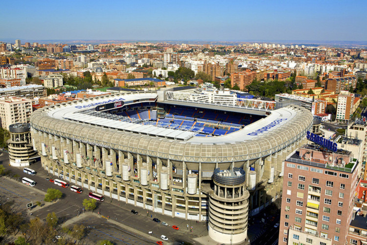 Santiago Bernabéu Stadium in Madrid. Photo via Flickr CC User Madrid2011jmj. Used under <a href='https://creativecommons.org/licenses/by-sa/2.0/'>Creative Commons</a>