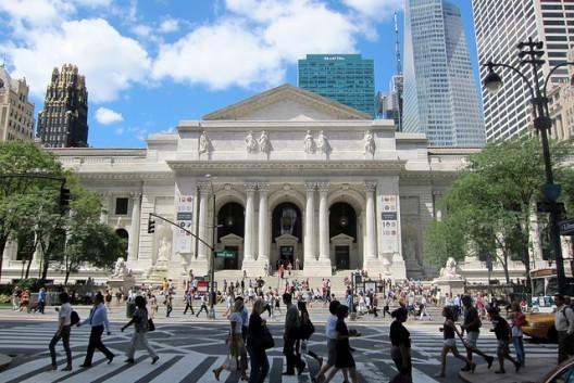 NYPL's main building on Fifth Avenue, is a Beaux-Arts masterpiece designed by architects Carrère & Hastings. Image © Flickr User CC wallyg