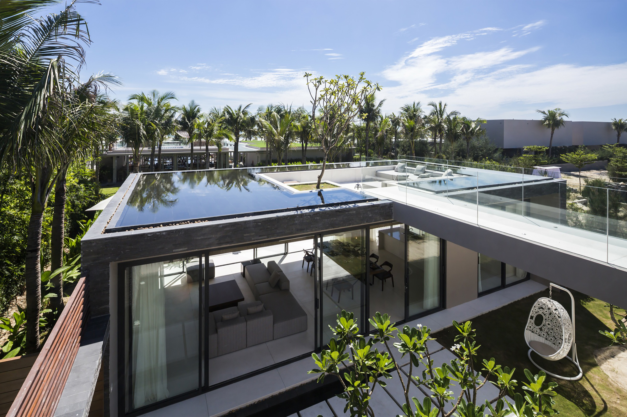 Gallery of naman residences villa b mia design studio 6 for Rooftop swimming pool designing and planning