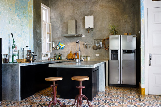 Conceptual artist Wilfredo Prieto's kitchen. He designed the kitchen himself and had it made by local craftspeople. Image Courtesy of Hannah Berkeley Cohen via Curbed