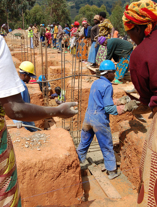 """Locals help to construct Butaro Hospital. Image Courtesy of MASS design group  MASS Design Group to Propose """"Bauhaus of Africa"""" at UN Summit stringio  1"""