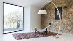 Showroom and Storage Room in an Old Barn / Michael Menuet