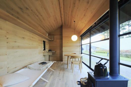 A wooden hut by Naoto Fukasawa. Image Courtesy of MUJI