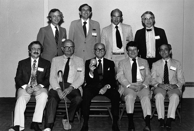 "Front row, from left to right: Frank Gehry, Charles Moore, Philip Johnson, Stanley Tigerman, and Robert A.M. Stern. Back row, from left to right: Michael Graves, Cesar Pelli, Charles Gwathmey, and Peter Eisenman. Philip Johnson's AIA Gold Medal acceptance, pictured with his ""kids,"" Dallas, Texas, 1978. Image © Courtesy Tigerman McCurry Architects"