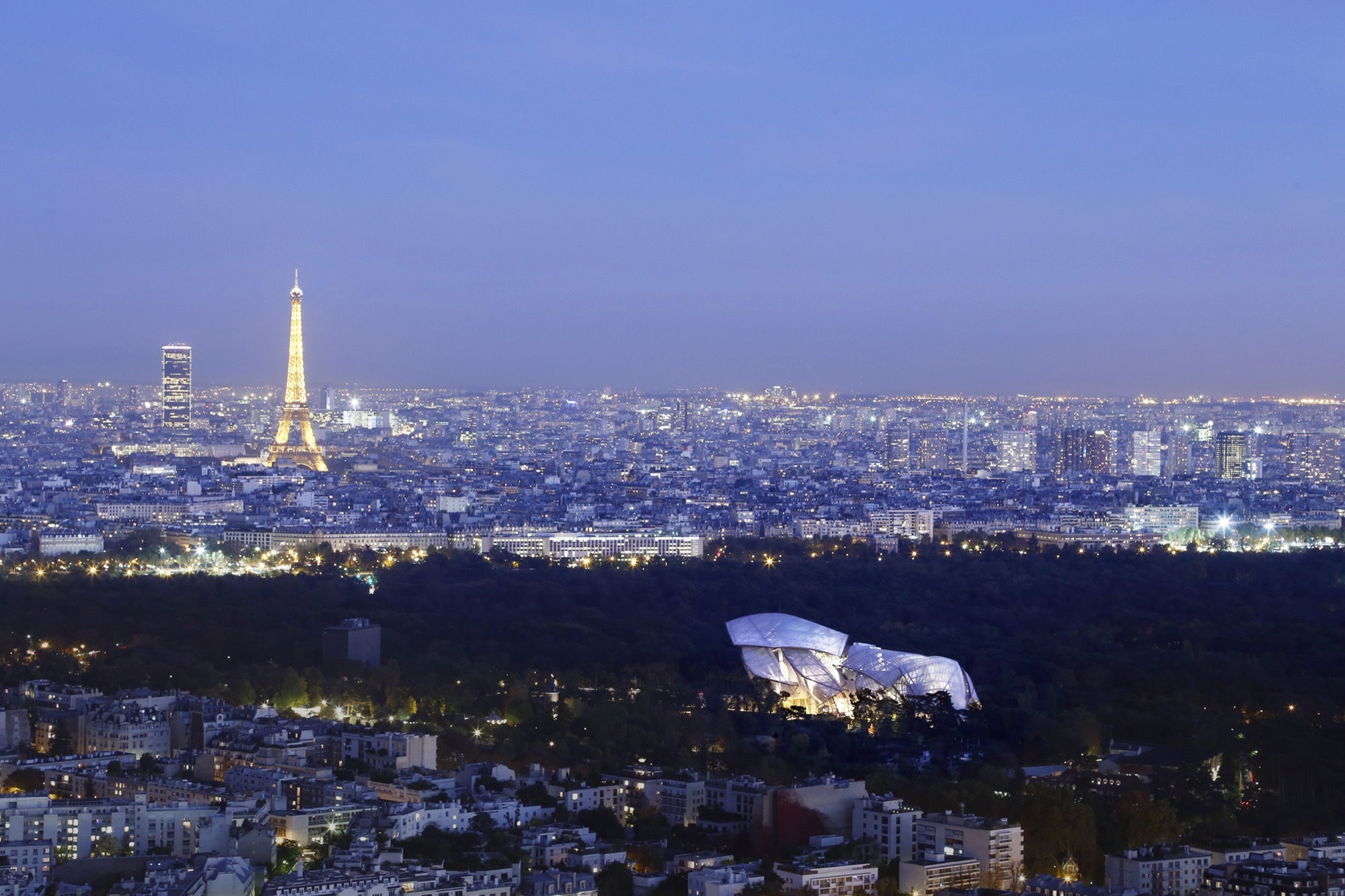 nightscape of paris france seen from a distance with the louis vuitton foundation in the. Black Bedroom Furniture Sets. Home Design Ideas