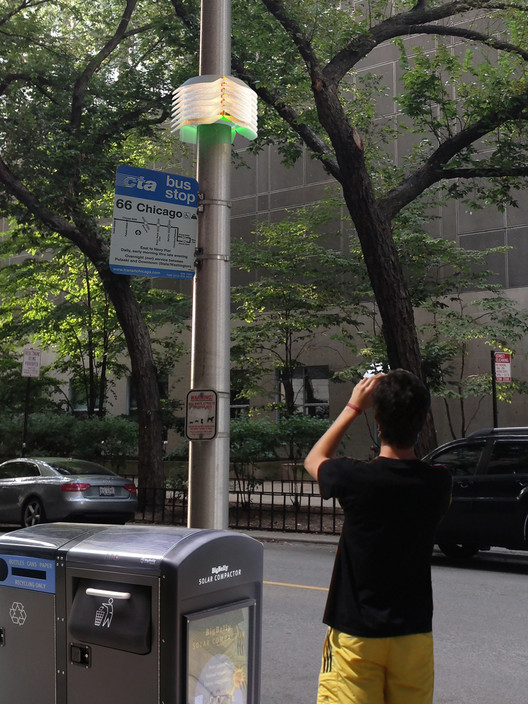Artist rendering of Array of Things nodes mounted on city streetlight poles. The AoT is an urban-sensing instrument, measuring data on cities' environment, infrastructure, and activity in order to scientifically investigate solutions to urban challenges ranging from air quality to urban flooding. Image Courtesy of Douglas Pancoast and Satya Mark Basu, School of the Art Institute of Chicago/AoT