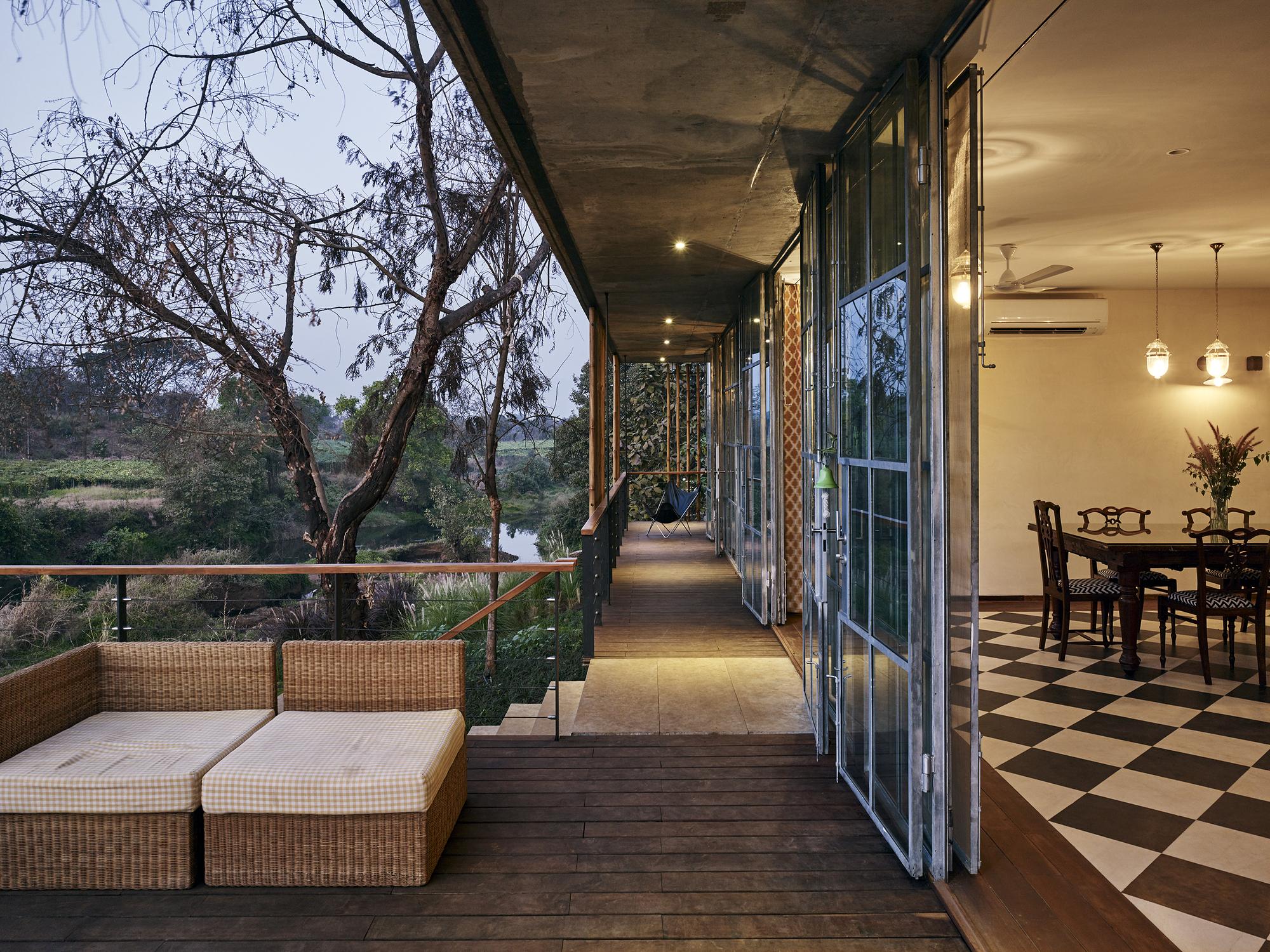 House design near river - Ariel Huber Edit Images