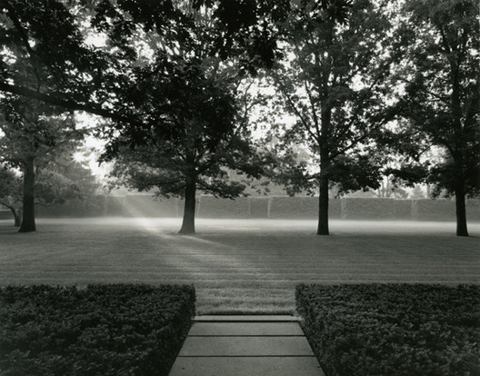 National Building Museum Talk: Luminous Landscapes - Photographs by Alan Ward, This black-and-white photograph, Sunrise over East Lawn taken at the Miller House and Garden in Columbus, Indiana emphasizes the design of the landscape using light, tone, and contrast. Photo by Alan Ward