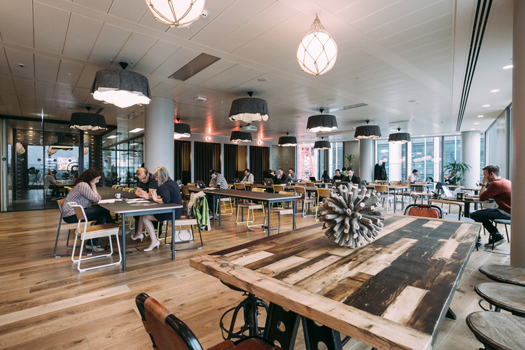 How Coworking and Coliving are Redefining Space as a Service, Common area in the WeWork space in London. Image © WeWork
