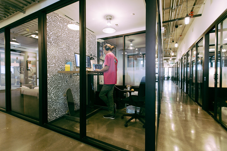 Private offices in the WeWork space in Seattle. Image © WeWork