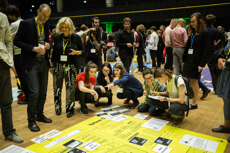 """Play the City,"" a giant interactive board game, that asked conference attendees to roleplay as the stakeholders in an imaginary city dealing with an influx of migrants. Image © Dorota Velek"