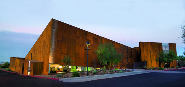 Why the Future of Civic Architecture Lies in Small-Scale Structures, Richärd + Bauer's Arabian Library in Scottsdale, Arizona, won an IIDA Metropolis Smart Environments Award in 2009 for its groundbreaking approach to both sustainability and community needs. The building's form and rusted-steel cladding were inspired by slot canyons in the Arizona desert. Image Courtesy of Richärd + Bauer