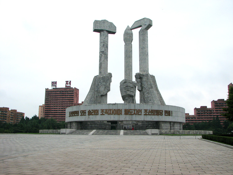 Architecture is Propaganda: How North Korea Turned the Built Environment into a Tool for Control, Workers' Party monument, a monument to the people showing the Hammer (builders), Sickle (farmers) and Paint Brush (scholars, an addition to the standard symbol of communism). Image © Alex Davidson