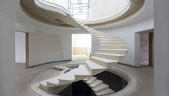 See The Engineering Behind This Floating, Award-Winning Stone Helical Stair