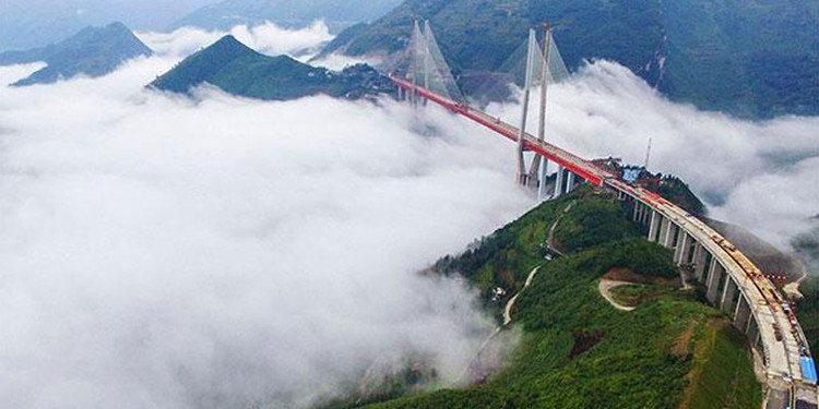 World's Highest Bridge Opens to Traffic in Southwest China, Image <a href='http://www.indialivetoday.com/beipanjiang-worlds-highest-bridge-inaugurated-in-china/87276.html'>via India Live Today</a>