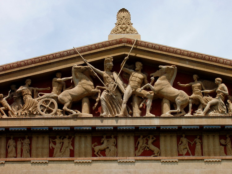 The west pediment of the reconstruction of the Parthenon in Nashville, Tennessee depicts Athena and Poseidon fighting for the rule of Attica while the other gods look on. ImageCourtesy of Flickr user damian entwistle (licensed under CC BY-NC 2.0)