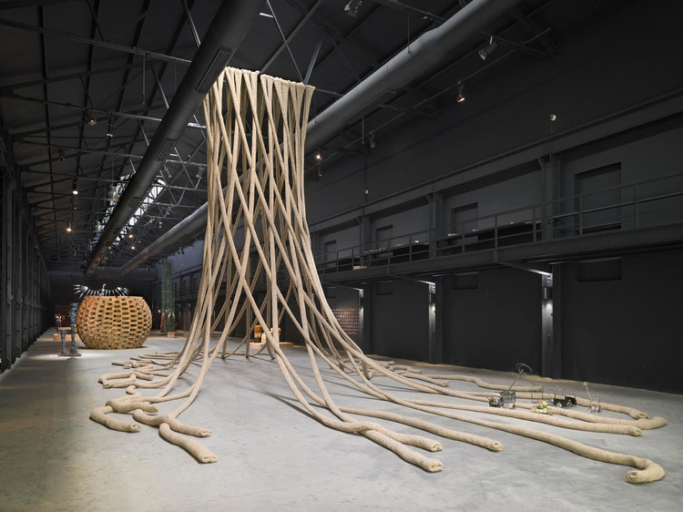 Humanity and Art Entwined - How NADAAA's Exhibit Became Blankets for Syrian Refugees, The exhibit was hung from the roof of the Electric Hanger exhibition hall. Image © Roland Halbe