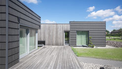 Black clay family residence with studio7