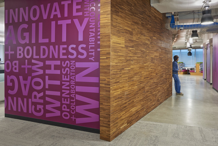 Symantec HQ - The building features a blend of natural materials, bold colouring, and branding. Image Courtesy of Little