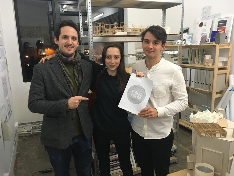 120 HOURS Project Manager, Seweryn Zawada (left), awarded the first prize diploma to Agenieszka Kołacińska (middle) and Jakub Andrzejewski (right) in a surprise visit Sunday evening. Image Courtesy of 120 Hours