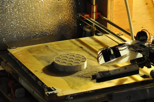 A 3D printer created by the University of Alaska team prints a cone for their entry in the Level 2, Phase 1 Compression Test Competition of NASA's 3D-Printed Habitat Competition. The university was awarded $14,070 for this stage of the challenge.. Image Courtesy of University of Alaska