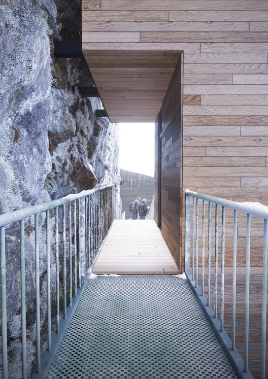 The facade is clad in horizontal timber to reduce perceived building height. Image Courtesy of Manofactory