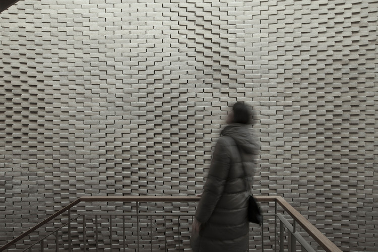 This Hand-Laid Brick Feature Wall Was Inspired by Soundwaves in Water, © 22quadrat gmbh