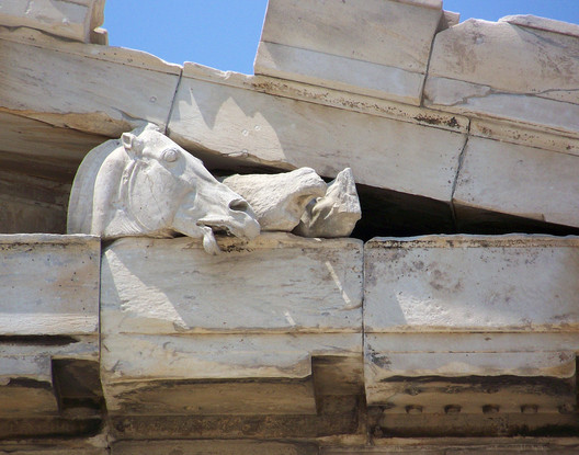 Sculptured Horse Head. Eastern Pediment. Image © Wikipedia User: Guillaume Piolle. Licensed Under CC BY-SA 3.0